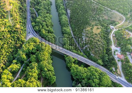 Aerial View Of The Bridge And The Road Over The River Pinios In The Green Valley Of Tempe In Greece