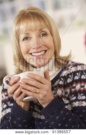 Portrait mature woman relaxing at home