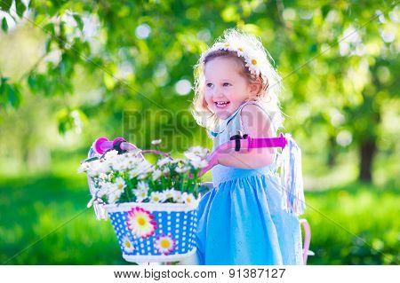 Little Girl Riding A Bike