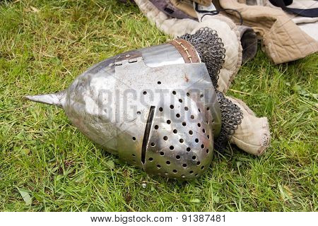 Medieval helmet fallen on the ground