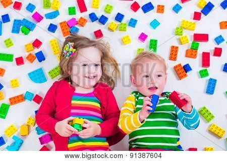 Kids Playing With Colorful Blocks