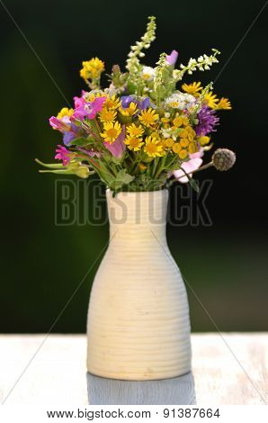 Beautiful bouquet of wildflowers in a vase
