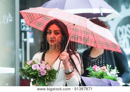 Woman With Posy On Street