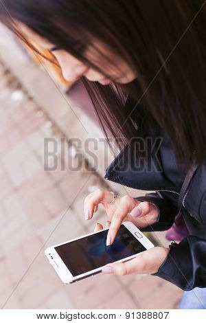 Beautiful Brunette Woman On A Walk In European City Using Her Smartphone Working. Outdoors. Focus On