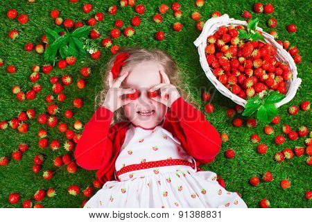 Little Girl Eating Strawberry