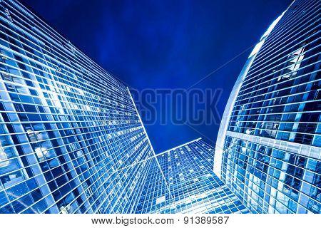 Hong kong,China-July 23,2014:low angle view of illuminated modern building exterior in Hong kong at night.