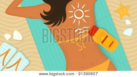 Young girl sunbathes on a beach