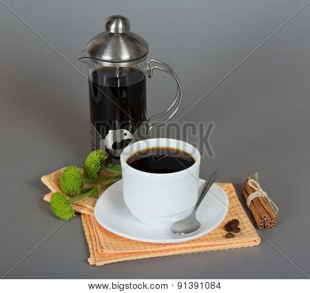 Coffeemaker and cup of coffee