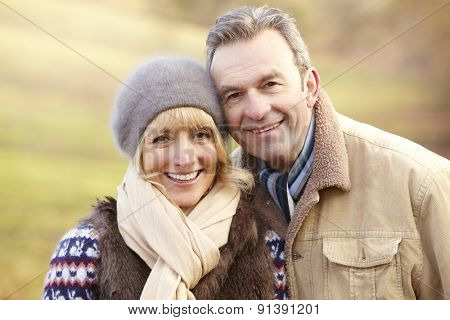 Portrait senior couple outdoors in winter