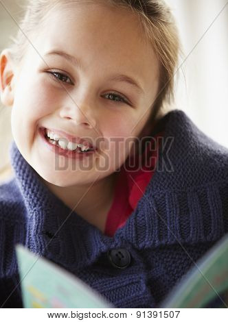 Young girl reading at home