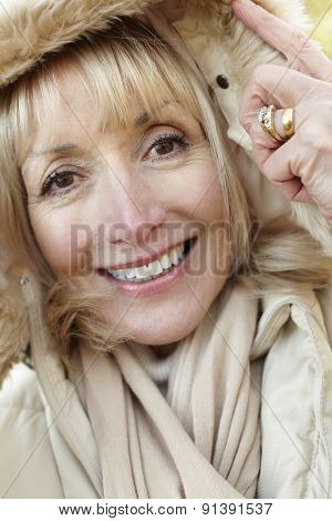 Mature woman wearing hooded coat