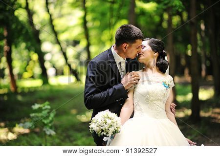Groom Kissing Bride