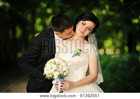 Groom Kisses On The Neck Bride