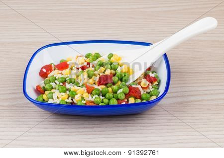 Vegetable Mix In Blue Bowl On Table And Plastic Spoon