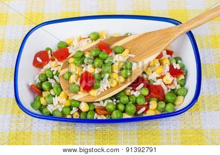Vegetable Mix In Bowl And Spoon On Plaid Tablecloth