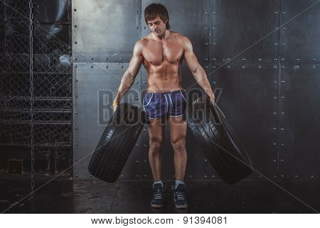 Sportsman athlete crossfit man working out exercising with a tires powerlifting healthy lifestyle bo