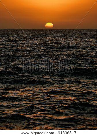 Setting Sun Over The Ocean