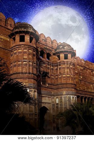 the full Moon over walls of the Red fort. India. Agra. Elements of this image furnished by NASA.