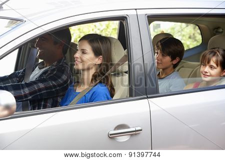 Family Setting Off On Car Journey