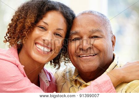 Senior African American man and granddaughter