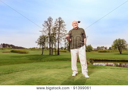 Man on course with golf club at shoulder