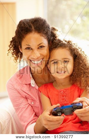 Mother and duaghter playing computer games
