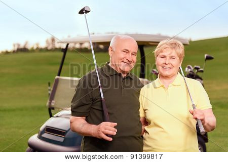 Senior man and woman on background of cart