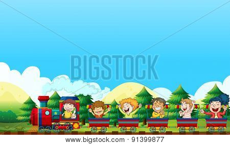 Children riding on a train in the park