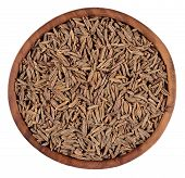 picture of cumin  - Cumin seeds in a wooden bowl on a white background - JPG