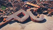 image of scrap-iron  - Rusty scrap metal in the yard - JPG