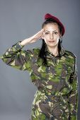 foto of army soldier  - Woman army soldier saluting isolated on gray background - JPG