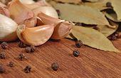 stock photo of peppercorns  - Garlic bay leaves and peppercorns close up - JPG