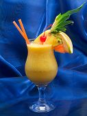 picture of pina-colada  - Pina Colada cocktail shot over blue background - JPG