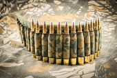 stock photo of hollow point  - camouflage ammunition belt for rifle on camouflage background - JPG