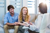 picture of psychologist  - Psychologist and happy couple in the office - JPG
