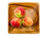 image of peach  - Peaches on wooden plate isolated over white background - JPG