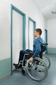stock photo of disability  - Disabled Man On Wheelchair Entering In Room - JPG