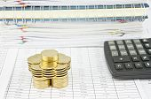 stock photo of piles  - Pile of gold coins and calculator on finance account have pile of paperwork and notebook as background - JPG