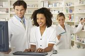 stock photo of nurse  - Nurse and pharmacists working in pharmacy - JPG