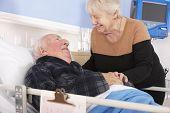 picture of visitation  - Senior woman visiting husband in hospital - JPG