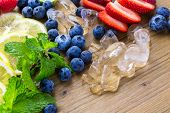 picture of infusion  - Sliced fresh organic fruits prepared to make infused water - JPG