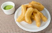 pic of dessert plate  - Snack and Dessert Chinese Traditional Snacks Deep Fried Doughstick on A White Plate Served with Pandan Coconut Custard Cream - JPG
