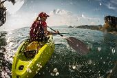 pic of kayak  - Young lady paddling the kayak in the sea with lots of splash - JPG
