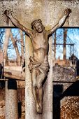 stock photo of cemetery  - Statue of crucified Jesus Christ at Rasu cemetery in Vilnius Lithuania - JPG