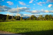 pic of power transmission lines  - Power lines on the background of beautiful cloudy sky and mountains - JPG