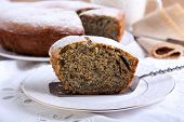 image of icing  - Poppy seed and raisin ring cake with icing sugar on top - JPG