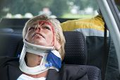stock photo of spinal cord  - woman with a neck brace to support her spinal cord after a severe car accident - JPG