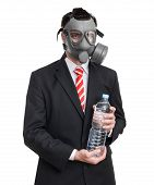 picture of gas mask  - Business man with gas mask holding bottle water isolated on white - JPG