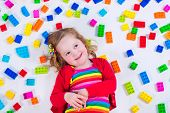 picture of girl toy  - Child playing with colorful toys - JPG
