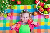 picture of healthy eating girl  - Child eating apple - JPG
